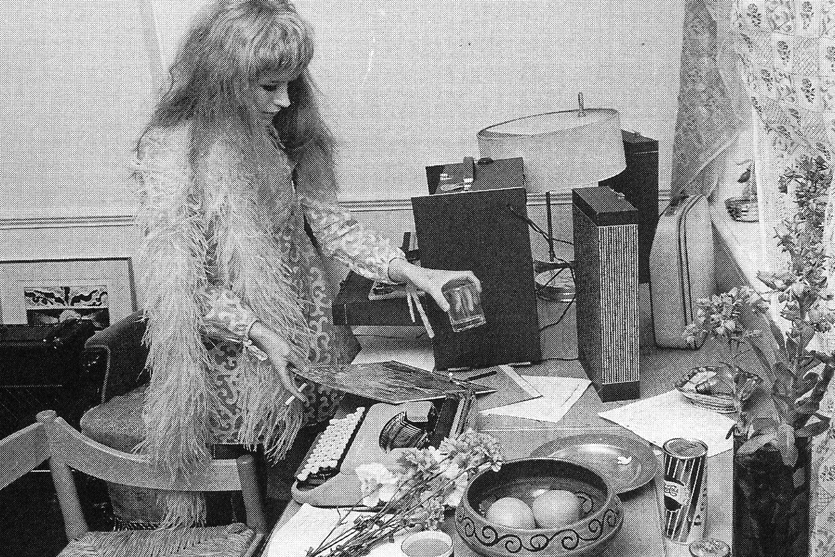 Marianne Faithfull at her office table
